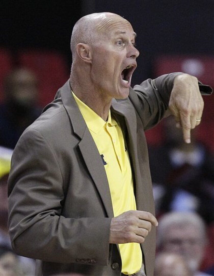 Michigan coach Kevin Borseth directs his players in the second half of an NCAA college basketball game against Maryland in College Park, Md., Wednesday, Nov. 30, 2011. Maryland won 74-65. (AP Photo/Patrick Semansky)