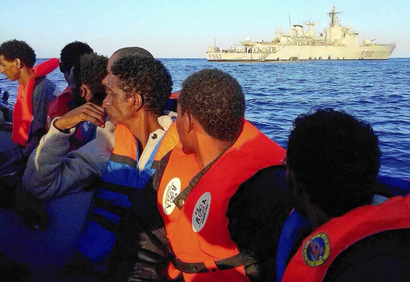 Migrants are en route to Italy after being rescued at sea in the Mediterranean by the Italian navy.