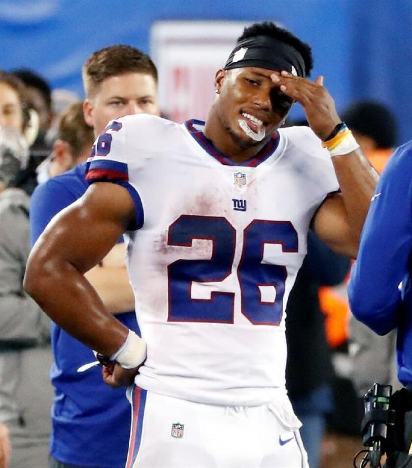 16-40. Barkley logra una anotación para la victoria de los Giants