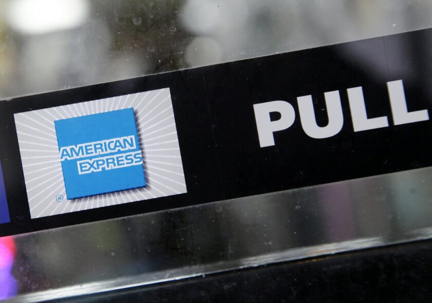 FILE - This Jan. 21, 2015 file photo ,shows the American Express logo displayed in the window of a New York business. American Express reports quarterly financial results on Wednesday, July 22, 2015. (AP Photo/Mark Lennihan, File)