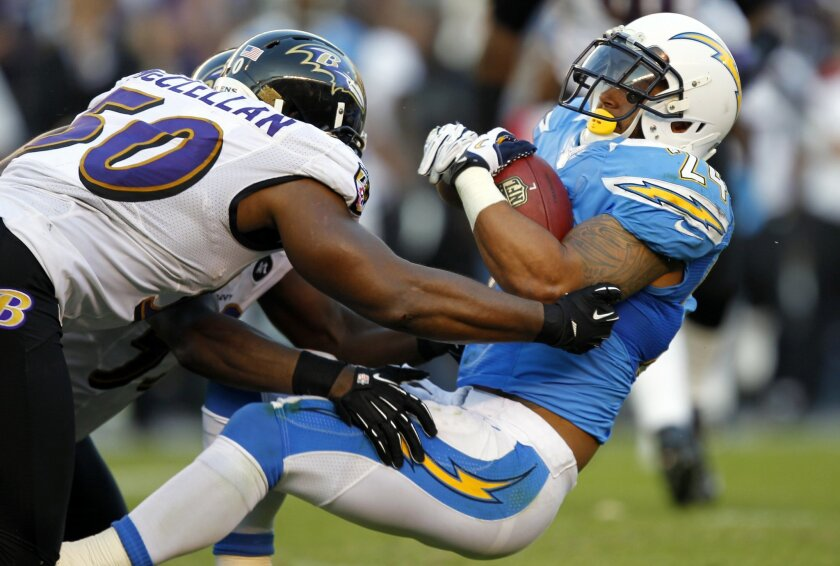 Chargers Ryan Mathews is tackled by Ravens Albert McClellan in the 4th quarter on Sunday, Nov. 25, 2012.