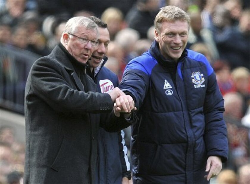 FILE - This is a April 22, 2012 file photo of Manchester United manager Sir Alex Ferguson, left, and Everton manager David Moyes during the Manchester United and Everton match at Old Trafford Manchester England . Everton said Thursday May 9, 2013 that its manager David Moyes is leaving the club at the end of the season and wants to replace Alex Ferguson at Manchester United. While United has not yet made an announcement on who will succeed Ferguson at Old Trafford, the statement from Everto