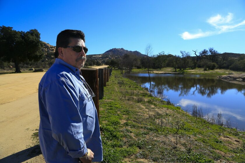 SAN DIEGO, CA, USA -- JANUARY 26, 2016:   Marc Halcon owner of the Covert Canyon Training Center, shown here walking a small portion of his 160 acres that will be used for military and law enforcement training just off Japatul Road and east of Alpine.   The grounds include 3 ranges, one of which is