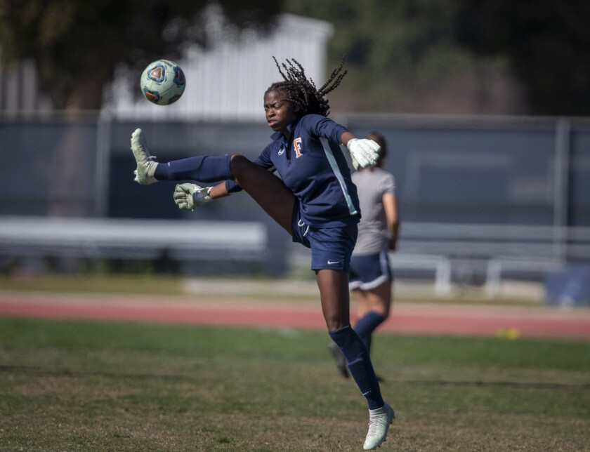 Cal State Fullerton soccer goal keeper DeAira Jackson, shown at practice, made the training squad for the U.S. Rugby Sevens Olympic team.