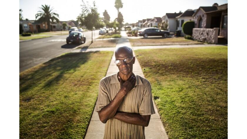 Former gang member Melvin Farmer on the street where he grew up.
