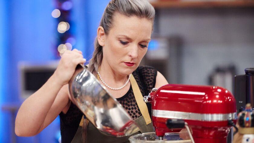 Contestant Maeve Rochford preparing her dish, Orange Chocolate Cake with Semi Sweet Chocolate Hazeln