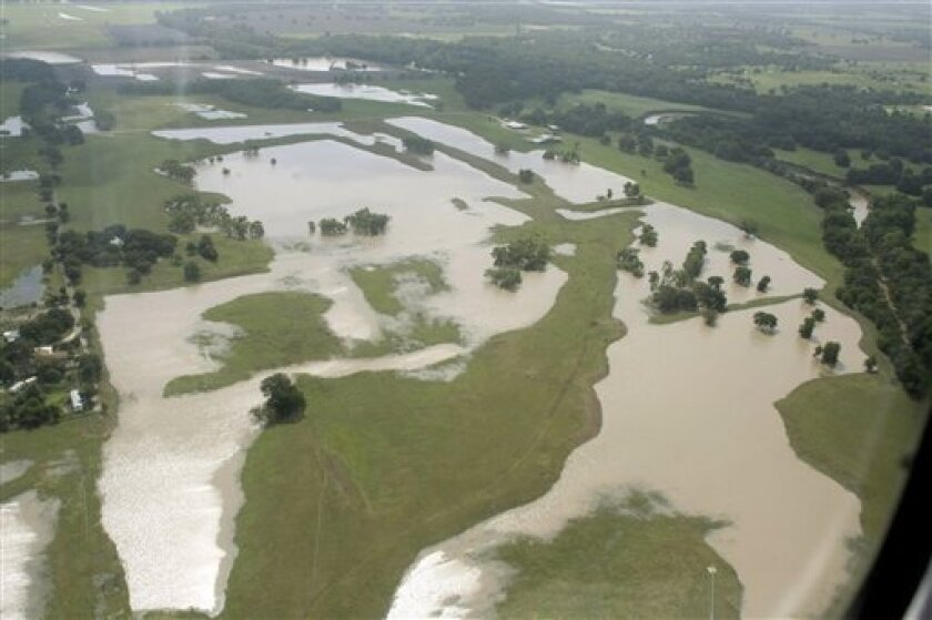 This aerial photo shows farmland near Temple, Texas on Thursday, Sept. 9, 2010, flooded by heavy rains from Tropical Storm Hermine. Texas Gov. Rick Perry toured central parts of the state Thursday and issued a disaster declaration for 40 counties. (AP Photo/Jack Plunkett)