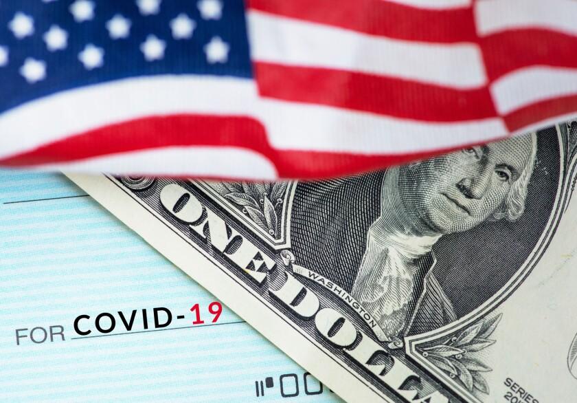 A dollar bill, Covid-19 check, American flag
