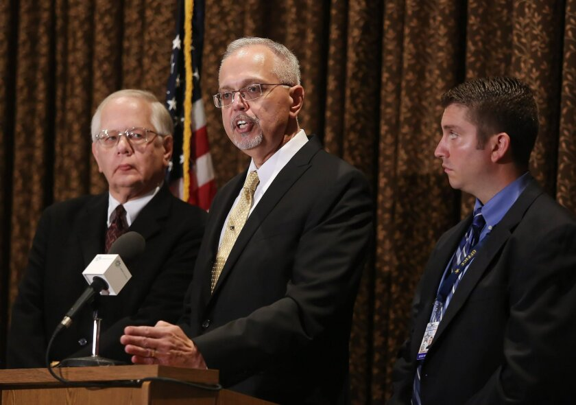 Lake County Coroner Dr. Thomas Rudd, left, Lake County Major Crime Task Force Cmdr. George Filenko, center, and Lake County sheriff's Detective Chris Covelli confirm that Fox Lake Lt. Charles Joseph Gliniewicz, 52, died Sept. 1 of a self-inflicted gunshot wound, during a press conference Wednesday,