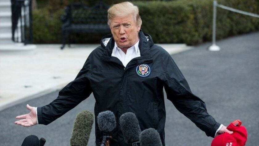 President Trump speaks to reporters March 8 before departing the White House to inspect tornado damage in Alabama and spend the weekend at his Florida resort.