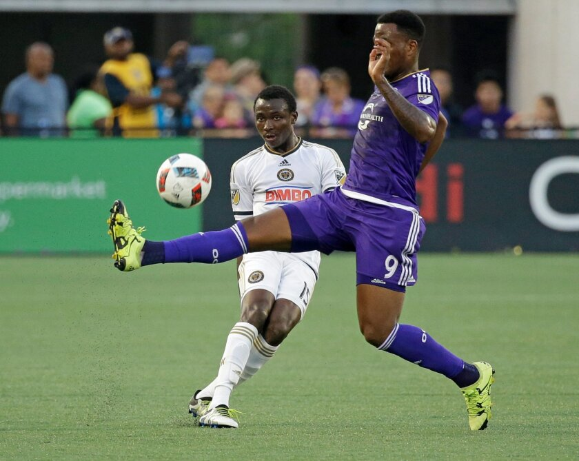 Orlando City 's Cyle Larin (9) tries to block a pass by Philadelphia Union's Joshua Yaro (15) during the first half of an MLS soccer game, Wednesday, May 25, 2016, in Orlando, Fla. (AP Photo/John Raoux)