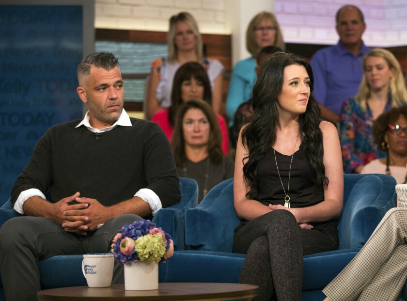 In this Aug. 27, 2018 photo released by NBC, Mark D'Amico, left, and Kate McClure speak with host Me