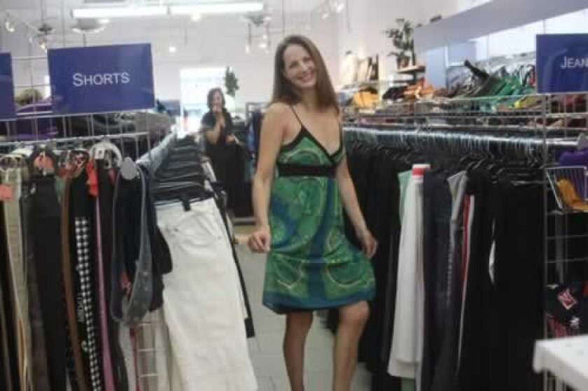Lindly garner shops for fashionable looks at Goodwill, see more at the SunSetter. Ashley Mackin