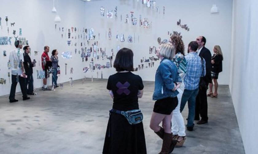 Attentive viewers at Margaret Noble's new exhibit at MCASD downtown.