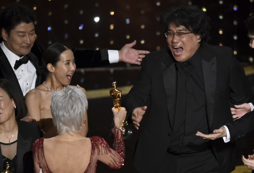 "FILE - Bong Joon Ho, right, reacts as he is presented with the award for best picture for ""Parasite"" from presenter Jane Fonda at the Oscars on Sunday, Feb. 9, 2020, at the Dolby Theatre in Los Angeles. Looking on from left are Kang-Ho Song and Kwak Sin Ae. (AP Photo/Chris Pizzello)"