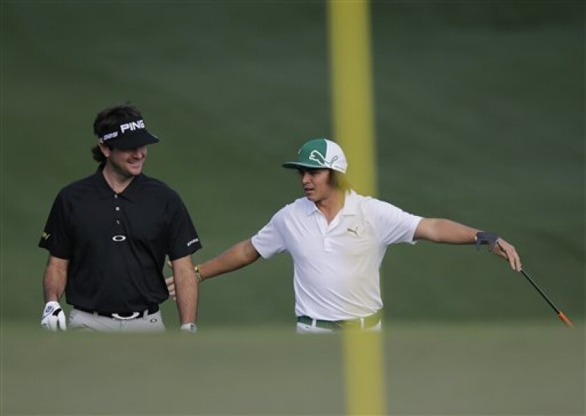 Bubba Watson, left, chats with Rickie Fowler on the second green during a practice round for the Masters golf tournament Monday, April 8, 2013, in Augusta, Ga. (AP Photo/Matt Slocum)