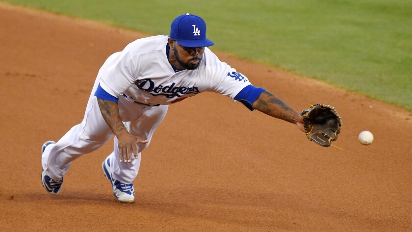 Dodgers second baseman Howie Kendrick can't make a diving stop on a single hit by San Francisco Giants left fielder Nori Aoki during the third inning of the Dodgers' 9-5 loss Friday.
