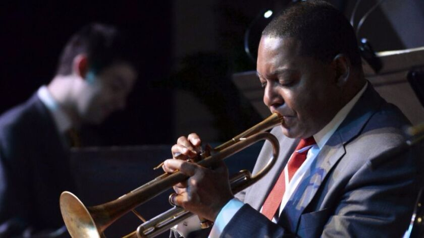 Jazz trumpet great Wynton Marsalis is so busy that he had to skip the Sept. 22 White House ceremony honoring him and this year's other National Medal of Arts and Humanities recipients.