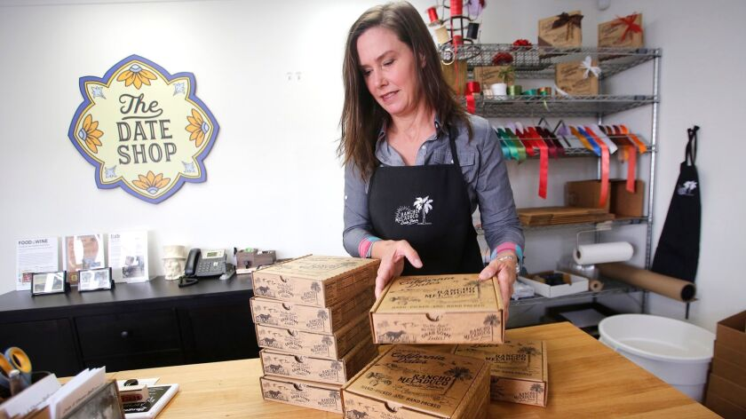 Joan Smith, founder and farmer of the Rancho Meladuco Date Farm, stacks online orders from her Newpo
