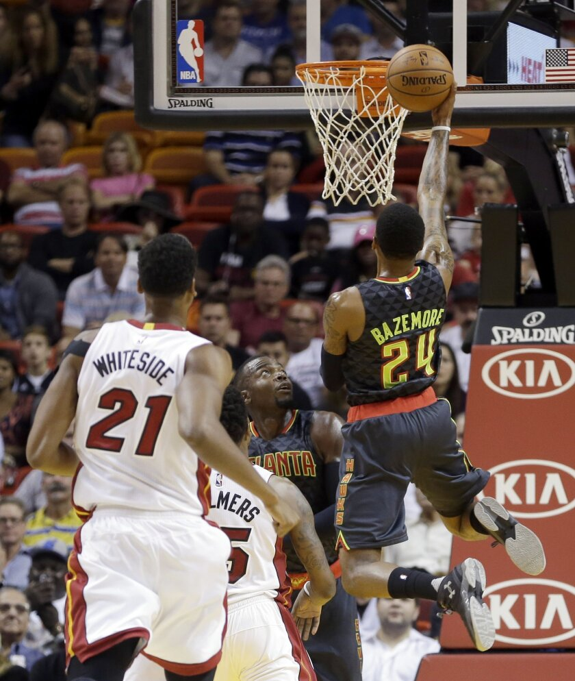 Atlanta Hawks guard Kent Bazemore (24) goes to the basket against the Miami Heat during the first half of an NBA basketball game, Tuesday, Nov. 3, 2015, in Miami. (AP Photo/Alan Diaz)