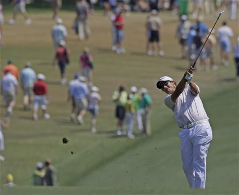 Adam Scott of Australia hits a shot on the first hole during the final round of the Masters golf tournament Sunday, April 10, 2011, in Augusta, Ga. (AP Photo/David J. Phillip)
