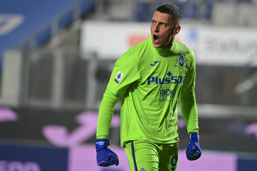 FILE - In this Sunday, Dec. 20, 2020 file photo, Atalanta goalkeeper Pierluigi Gollini yells out during the Italian Serie A soccer match between Atalanta and Roma at the Gewiss Stadium in Bergamo, Italy. Tottenham Hotspur signed Italian goalkeeper Pierluigi Gollini from Italian club Atalanta on a season-long loan with an option to make the move permanent, the team said Saturday July 24, 2021. (Fabio Rossi/LaPresse via AP, File)