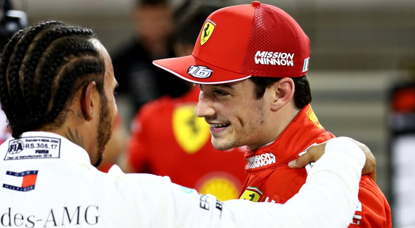 Ferrari driver Charles Leclerc is congratulated by Mercedes driver Lewis Hamilton after winning pole position at the Bahrain Grand Prix on Saturday.