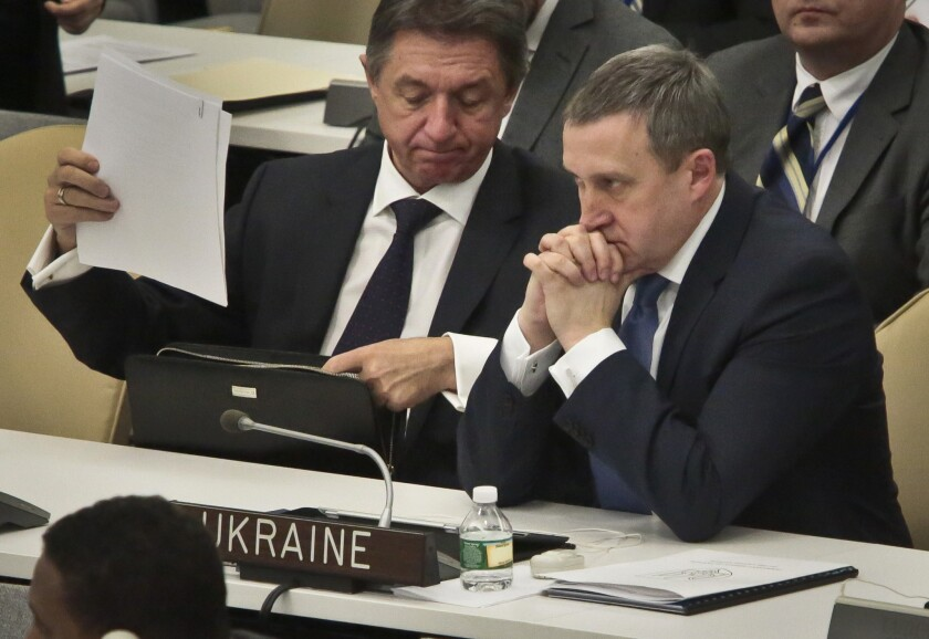 Yuriy Sergeyev, Ukrainian Ambassador to the U.N., left, and Ukraine's acting Foreign Minister Andrii Deshchytsia, right, listen to speakers as the General Assembly debates a resolution rebuking Russia for its actions in Crimea.