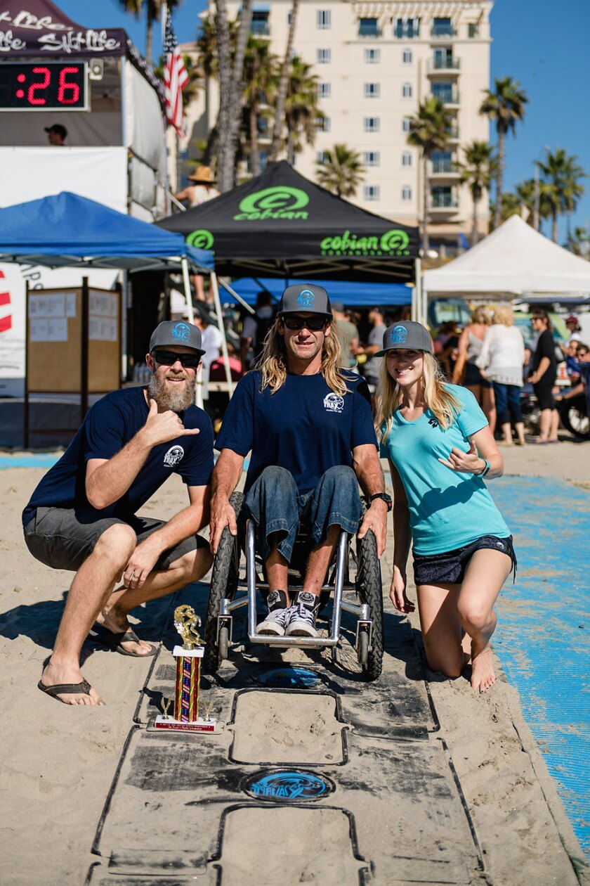 Access Trax co-founders Eric Packard (left) and Kelly Twichel (right) with adaptive surfer Bruno Hansen (center).