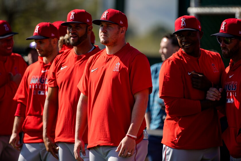 Angels center fielder Mike Trout (27), center, and the Angels at practice at Tempe Diablo Stadium on Feb. 17.