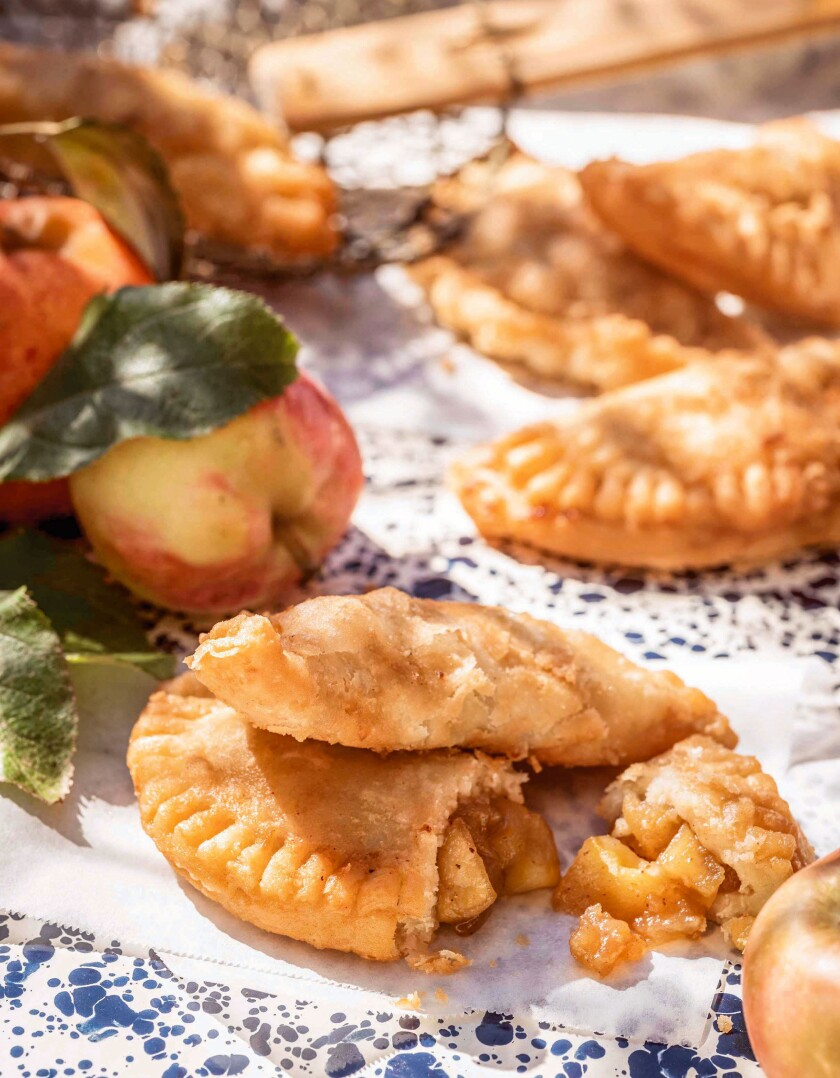 """This cover image released by Mariner Books shows a recipe titled """"Jack's Fried Pies,"""" from the cookbook """"Trisha's Kitchen: Easy Comfort Food for Friends and Family"""" by Trisha Yearwood. (Ben Fink/Mariner Books via AP)"""