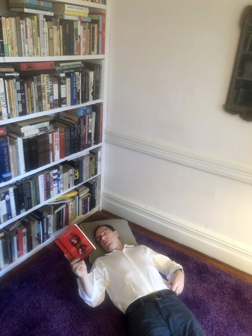 American journalist / Author Henry Alford lying on the floor of his apartment in New York?s Greenwic
