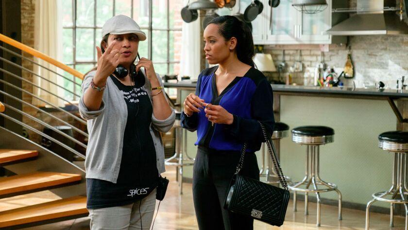 "Latinx director Aurora Guerrero, left, instructs actress Dawn-Lyen Gardner in an episode of ""Queen Sugar."""
