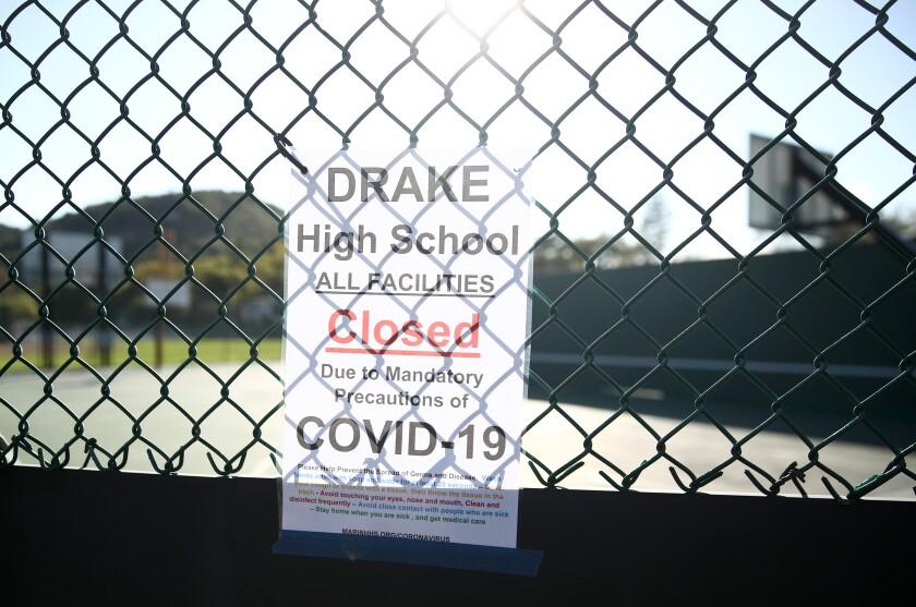 A coronavirus-related shutdown sign, posted outside Sir Francis Drake High School in San Anselmo, Calif.