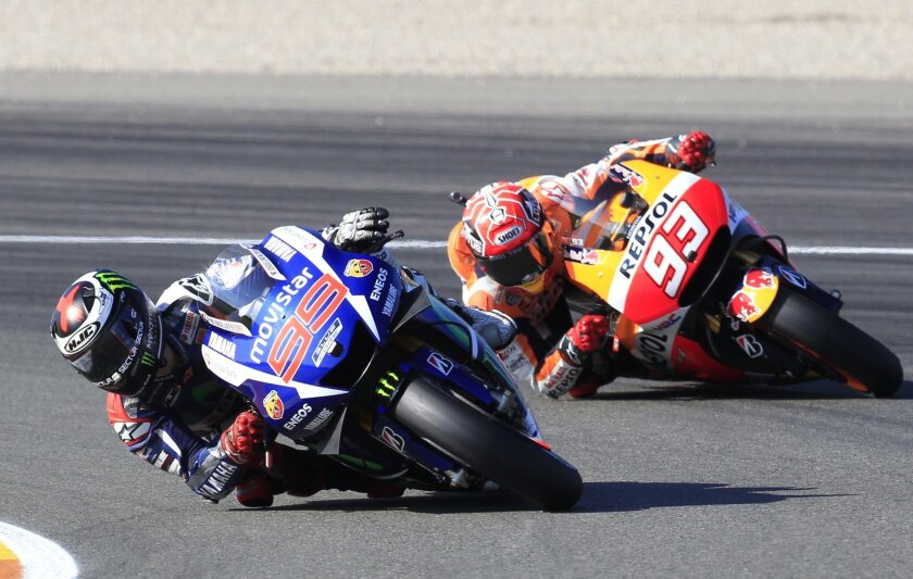 MotoGP rider Jorge Lorenzo of Spain leads the race followed by Marc Marquez, during the Valencia Motorcycle Grand Prix, the last race of the season, at the Ricardo Tormo circuit in Cheste near Valencia, Spain, Sunday, Nov. 8, 2015. (AP Photo/Alberto Saiz)