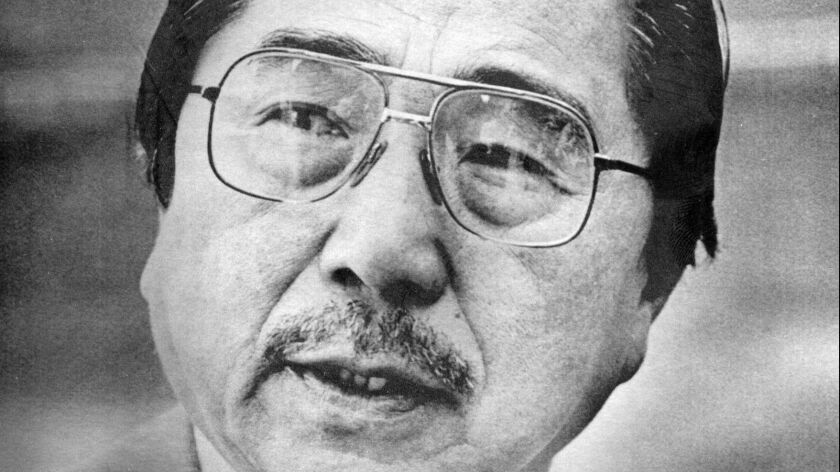 Gordon Hirabayashi talks with reporters while enroute to Federal Courthouse in Seattle in 1985.