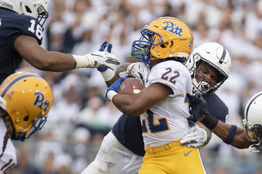 Penn State linebacker Micah Parsons tackles Pittsburgh running back Vincent Davis on Saturday.