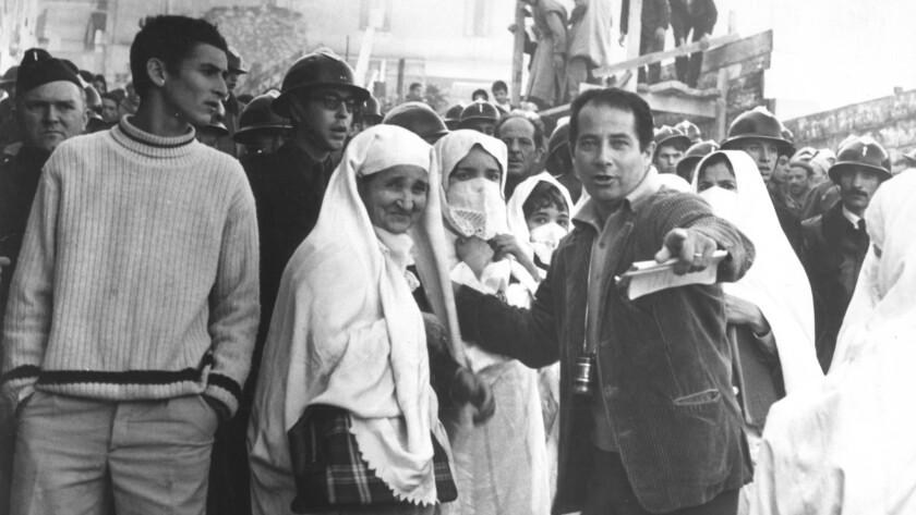 "Gillo Pontecorvo (at right, pointing) directing ""The Battle of Algiers."""