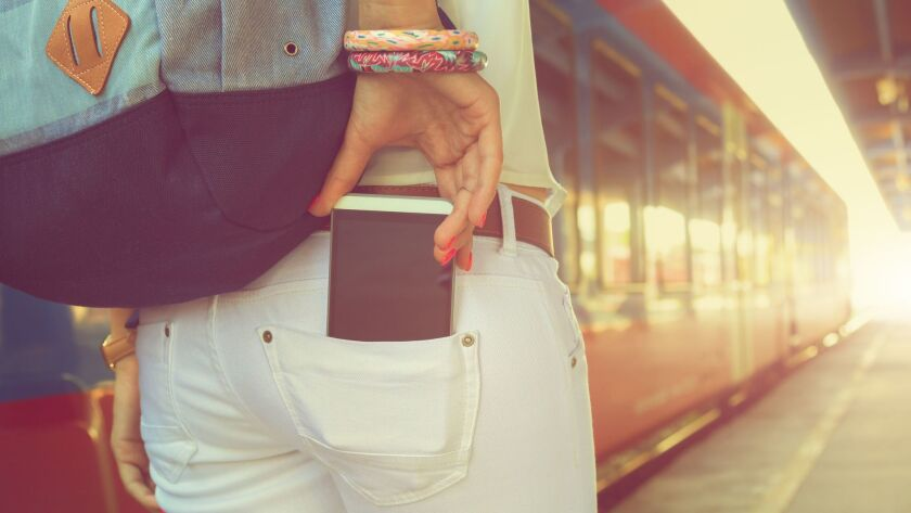 Taking cellphone from/to the pocket on railway station.
