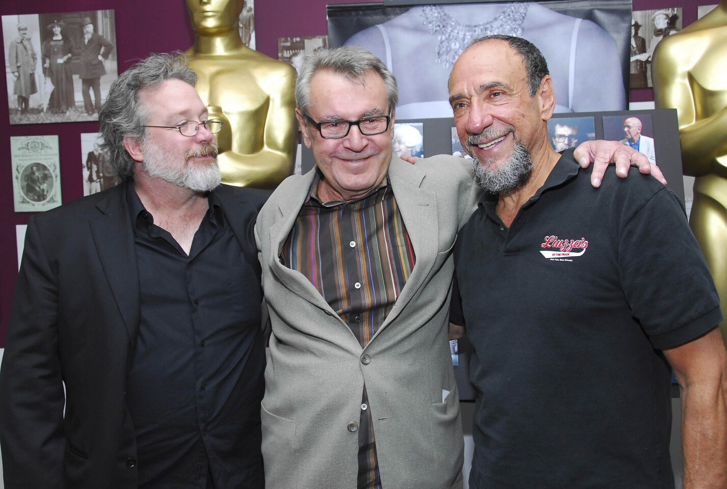 """Milos Forman is flanked by actors Tom Hulce, left, and F. Murray Abraham at the Academy of Motion Pictures Arts and Sciences' screening of """"Amadeus"""" in July 2007 in New York."""
