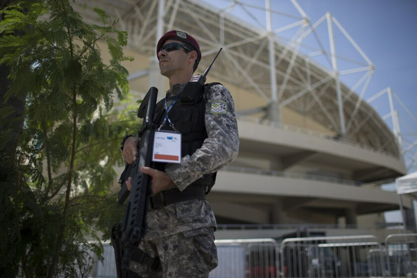 A police officer stands guard in front of the Maria Lenk Aquatics Center, at the Olympic Park in Rio de Janeiro, Brazil, Friday, Feb. 19, 2016. More than 280 security personnel are in place to safeguard the Aquatics Center, athletes, and public attending the ongoing FINA World Diving Cup. The secur