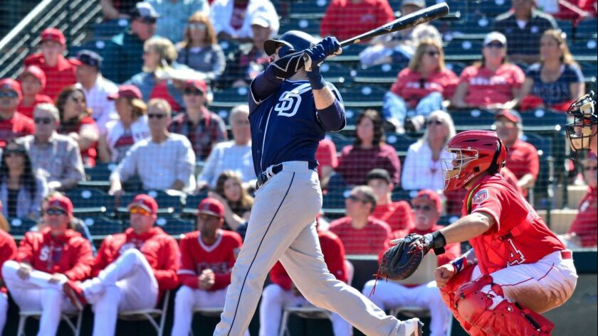Padres catcher Austin Hedges hits a home run against the Los Angeles Angels on Feb. 25.