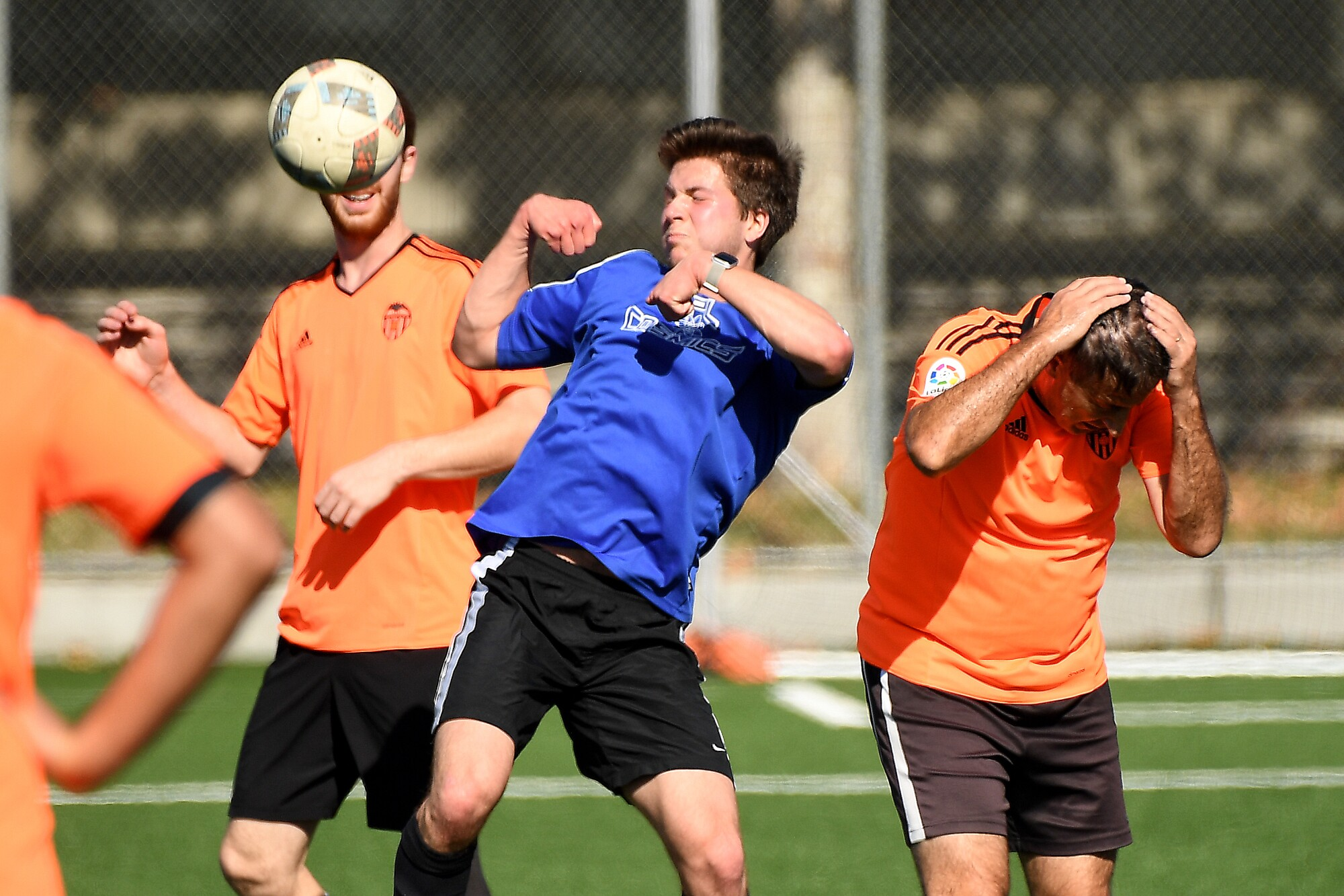 Robert Gray, center, battles for the ball during a Nerd Soccer League game at Caltech in Pasadena.