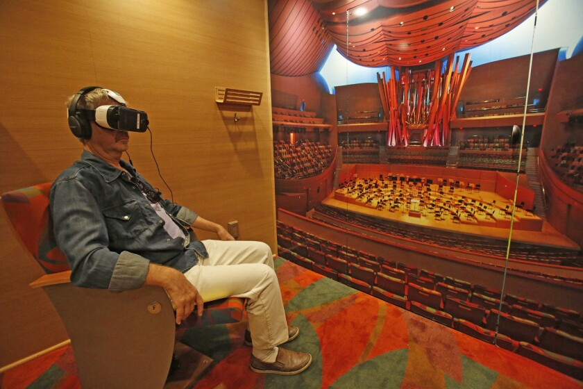Neal Taylor watches and listens a Los Angeles Philharmonic performance via a virtual reality headset in the orchestra's Van Beethoven.