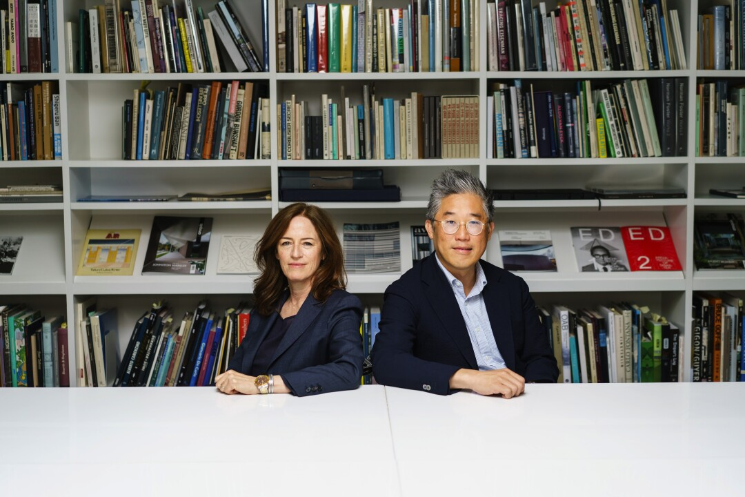 Sharon Johnston and Mark Lee in their studio's library in 2019.