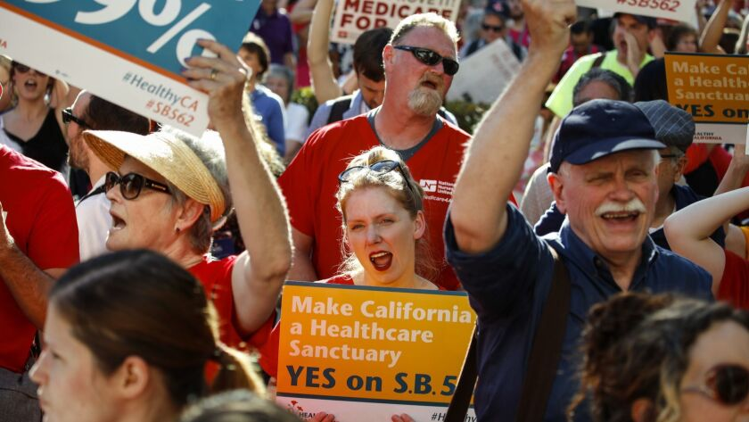People march in support of a single-payer healthcare system at the Capitol in Sacramento on 19, 2017.