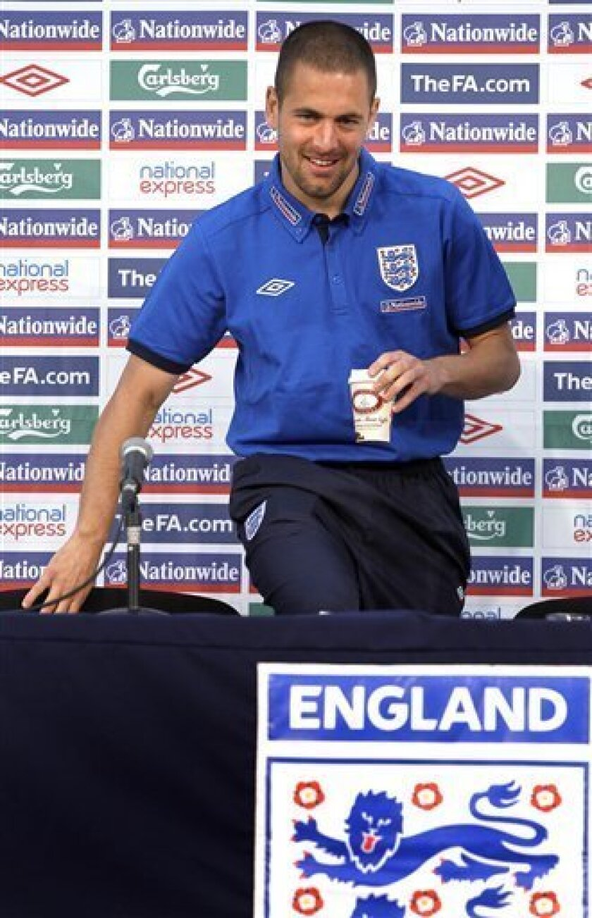 England soccer player Joe Cole arrives for a press conference in Rustenburg, South Africa, Wednesday June 9, 2010. England are preparing for the upcoming soccer World Cup, where they will play in Group C. (AP Photo/Kirsty Wigglesworth)