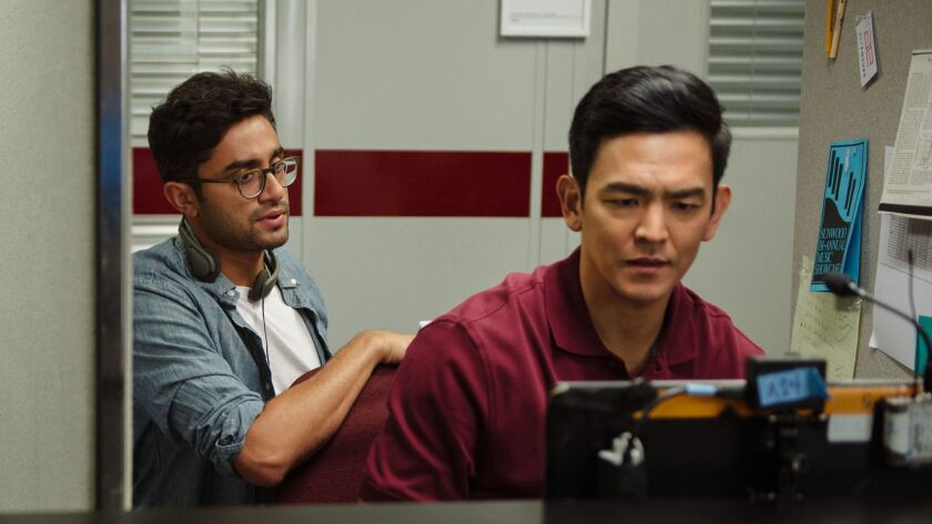 """Director/writer Aneesh Chaganty and John Cho on the set of Screen Gems' """"Searching"""" movie."""
