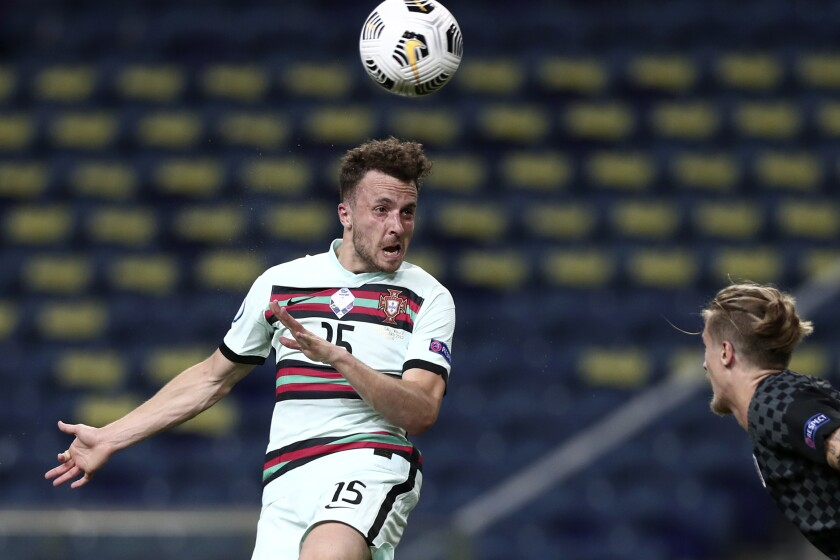 Portugal's Diogo Jota heads the ball in front of Croatia's Tin Jedvaj during the UEFA Nations League soccer match between Portugal and Croatia at the Dragao stadium in Porto, Portugal, Saturday, Sept. 5, 2020. (AP Photo/Miguel Angelo Pereira)