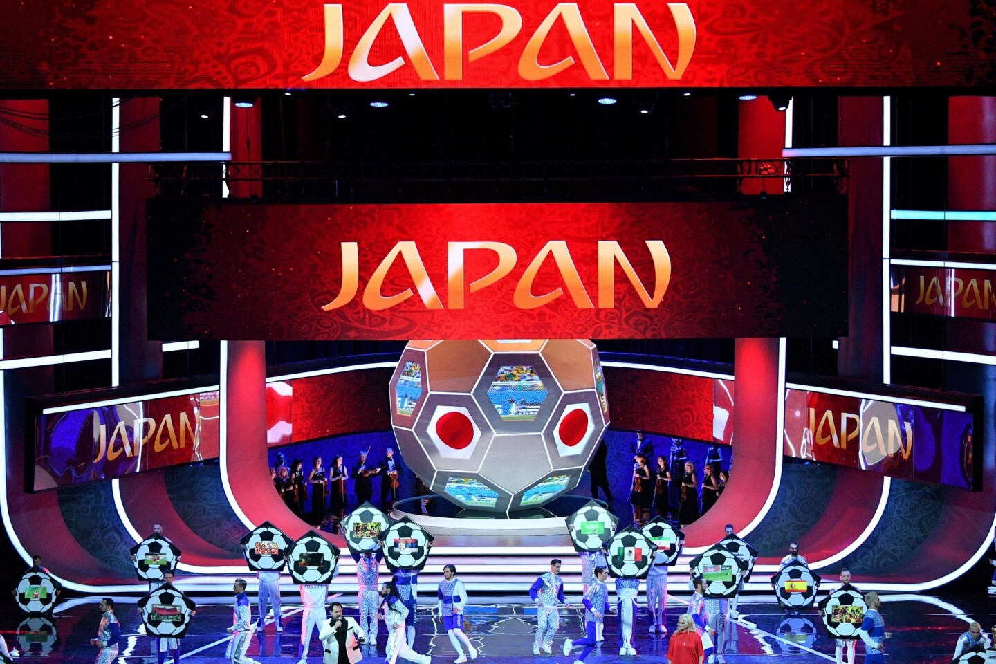 """Artists perform on stage as """"Japan"""" is displayed on screens during the Final Draw for the 2018 FIFA World Cup football tournament at the State Kremlin Palace in Moscow on December 1, 2017. The 2018 FIFA World Cup will be held from June 14 and July 15, 2018, in 11 Russian cities. / AFP PHOTO / Mladen ANTONOVMLADEN ANTONOV/AFP/Getty Images ** OUTS - ELSENT, FPG, CM - OUTS * NM, PH, VA if sourced by CT, LA or MoD **"""